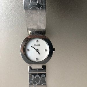 Coach silver watch.